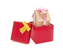 House wrapped with ribbon in a present box Royalty Free Stock Image