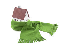 House wrapped in a scarf. House miniature wrapped in a green scarf Royalty Free Stock Photos