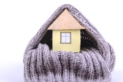 House wrapped in wool scarf Royalty Free Stock Photo