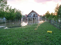 House with a yard after a flood Royalty Free Stock Images
