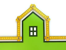 House from yard stick on white background . Stock Photos