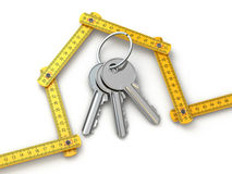 House from yardstick and bunch of keys. Stock Image