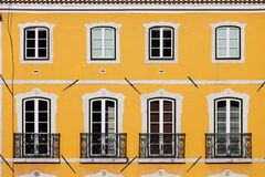 House with Yellow Facade Royalty Free Stock Images