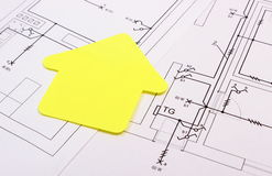 House of yellow paper on construction drawing, concept of building home Stock Photography