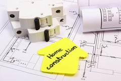 House of yellow paper, electric fuse and construction drawing Stock Photos