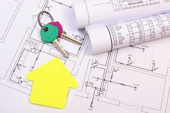 House of yellow paper, home keys, rolls of diagrams on construction drawing Stock Photos