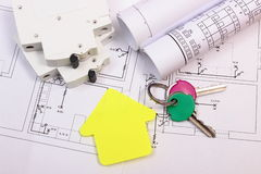 House of yellow paper, keys, electric fuse and construction drawing Stock Photo