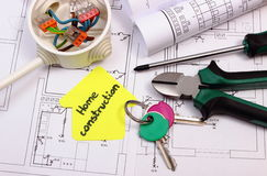 House of yellow paper, keys, electrical box and construction drawing Stock Photo