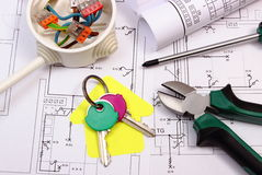 House of yellow paper, keys, electrical box and construction drawing Royalty Free Stock Images