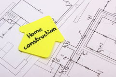 House of yellow paper with text home construction on construction drawing of house Stock Images