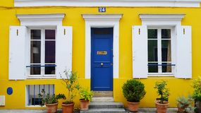 House. Yellow house in Paris royalty free stock images