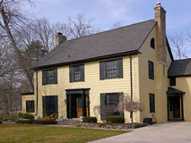 House with  yellow siding Stock Image