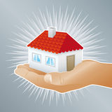 House for you. A hand giving a house Royalty Free Stock Photography