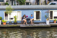 Houseboat in Amsterdam stock photography