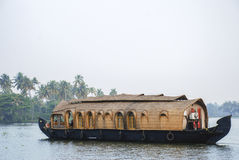 Houseboat on the backwater in Kerela. A houseboat sailing in the backwaters of Kerela, India Stock Photos