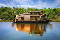 Houseboat in backwaters in India. Houseboat in backwaters on a background of the palm tree plantation Royalty Free Stock Photography