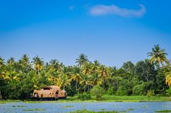 Houseboat in backwaters of Kerala, India. Houseboat moored at a picturesque location in Kerala, India stock photo