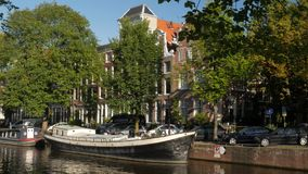 Houseboat on Brouwersgracht Canal in Amsterdam stock video