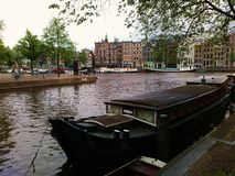 Houseboat on Amsterdam canal. A houseboat like typical living in Amsterdam Royalty Free Stock Photo