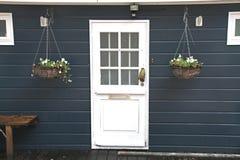 Houseboat door. Blue houseboat with white door Stock Photography
