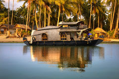 Houseboat in India. Houseboat in backwaters on a background of the palm tree plantation Royalty Free Stock Photos