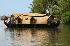 Houseboat in India. A thatched roof houseboat on the backwaters in the tropical state of Kerala, India Royalty Free Stock Photography