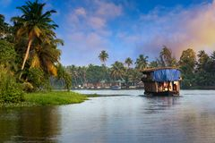 Houseboat in Kerala, India. A traditional house boat is anchored on the shores of a fishing lake in Kerala`s Backwaters, Kerala, India stock photo