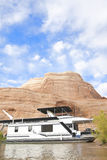 Houseboat on the Lake. A houseboat on a beautiful lake in the southwestern United States. Lake Powell, Utah or Glen Canyon National Recreation Area. Lots of copy Stock Photography