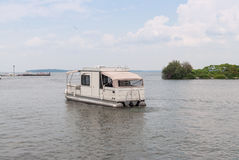 Houseboat on a lake Stock Photography