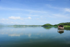 Houseboat, lake, moutain and sky in Thailand Stock Image