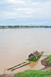 Houseboat in mekong river. Life in houseboat living in mekong river,park near the shore in nongkai province, Thailand.Mekong river seperates Thailand and Laos Stock Photos
