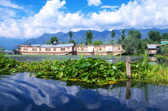 Houseboat in moored in Dal Lake-12. A beautiful and rich royal houseboat standing in lake in Kashmir Royalty Free Stock Photography