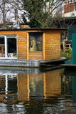 Houseboat. A houseboat moored on the Grand Union Canal. Because of the high price of traditional property in London more and more people are looking at cheaper Royalty Free Stock Image