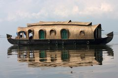 Houseboat reflection. Reflection traditional houseboat in Kerala backwaters stock photo