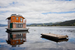 Houseboat on river. A houseboat moored near a pier on the river Royalty Free Stock Photography