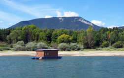 Houseboat and Rohace in summer Royalty Free Stock Photos