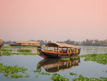 A houseboat sailing in kerala backwaters during sunset. royalty free stock image