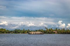 Houseboat with sky and palm tree stock photos