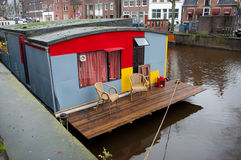 Houseboat with small terrace. Houseboat in Dutch canal, used by prostitutes Stock Image