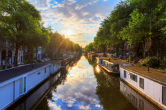 Houseboat sunrise Amsterdam Royalty Free Stock Photography