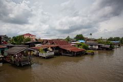 Houseboat in Thailand. Houseboat and river with blue sky in Thailand Royalty Free Stock Photo