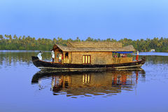 Houseboat. Tourist spend night in still backwater on luxury houseboat. In this shot a tourist is taking snap Stock Photography