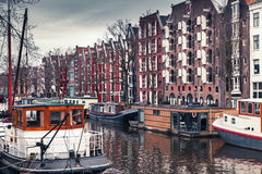 Houseboats along the canal in Amsterdam Stock Photography