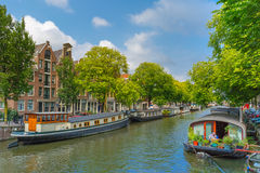 Houseboats on Amsterdam canal, Holland. Royalty Free Stock Images