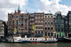 Houseboats and Dutch architecture in Amsterdam Royalty Free Stock Photo