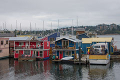 Houseboats in harbor, Victoria, BC, Canada. Houseboats in harbor at Victoria, British Columbia, Canada on overcast day stock photography
