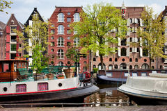 Houseboats and Houses on Brouwersgracht Canal in Amsterdam Royalty Free Stock Image