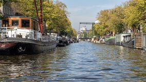 Houseboats lining a canal in Amsterdam, The Netherlands royalty free stock images