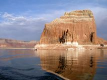 Houseboats at a monolith at Lake Powell. Giant monolith rises from Lake Powell Royalty Free Stock Photography