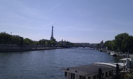 Houseboats on the Seine in front of the Eiffel  Tower Stock Image
